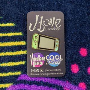 """Animal Crossing"" Switch Console Enamel Pin (Green & Blue)"